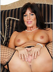 Playful tart Tara Holiday taking off all clothes and fingering on the sofa