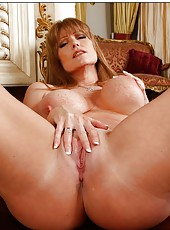 Smiley housewife Darla Crane showing juicy melons and fingering on the bed