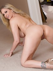 Wonderful blonde Julia Ann posing on the floor and playing with her snatch