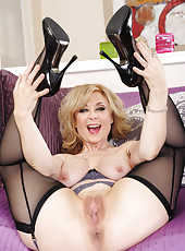 Giggly slut Nina Hartley masturbating in lingerie and reaching climax