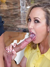 Foxy slut Brandi Love enjoys stripping on camera and swallowing big rods