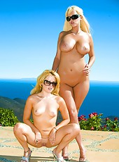 Outdoor posing of sexy bikini models Carly Parker and Sindee Jennings