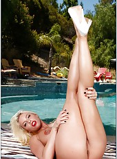 Astounding babe Britney Amber posing at the pool and making a deepthroat