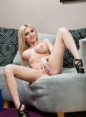 Glamorous babe Christie Stevens poses for the audience and masturbates