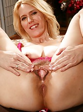 Raunchy MILF Trish with her small tits posing and getting naked here