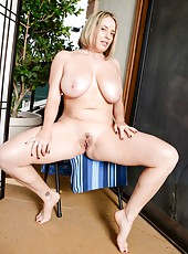 Curvy babe Maggie Green with big tits spreading her legs very wide