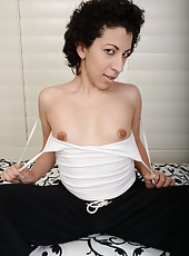Arresting mature bitch Kinky Gaga playing with her nipples and pussy
