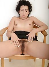 Erotic and snazzy mature Kinky Gaga playing with her wet pussy here