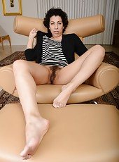 Gorgeous MILF Kinky Gaga playing with her hairy pussy and showing ass
