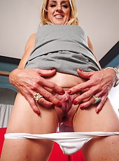Lovely blonde MILF Ava showing her cunt in a close up view for you