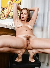 Magnificent MILF Miss Melrose undressing and spreading her legs wide