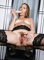 Horny and sexy mature slut Miss Melrose using a dildo to please her twat