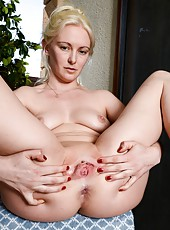 Lovely blonde MILF Skye Daniels spreading her legs and showing her twat