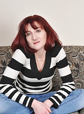 Mature redhead whore Kelly spreading her legs and showing her pussy