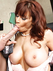 Mature mommy Devon Michaels is sucking this dick and giving a good titjob