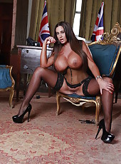 Big-tit tanned model Emma Butt poses topless in her corset so erotic