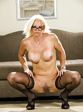Stunning leggy milf in black stockings Rhylee Richards is posing with naked pussy