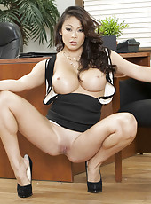 Pretty stunning leggy Asian milf Mia Lelani shows off her unnatural boobs
