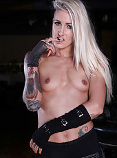Arresting blonde babe Angel Long showing her tiny tits and her tattoos