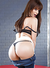 Super hot MILF Emily Addison doing a spectacular striptease for the camera