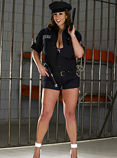 Busty MILF with big tits Ashley Graham showing her tasty body in the jail