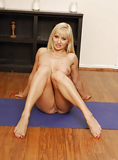 Passionate yoga with a gorgeous busty blonde milf whose name is Lea Lexis
