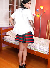 Pretty schoolgirl with two sexy pigtails Juelz Ventura shows her trimmed pussy