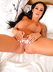 First-class milf with hot tattoos and big tits Angelina Valentine strips in the bedroom