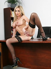Luxury blonde business lady Nikki Benz shows off her charms in the office