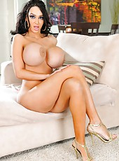 Astounding Amy Anderssen showing enormous boobs and posing on camera