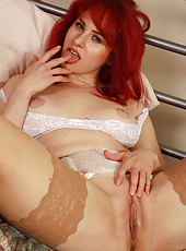 33 year old redhead Andrea Rosu showing off her very nice large tits