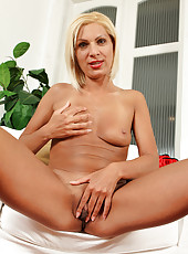 Wearing sexy red lace 37 year old Mary Blade spreads her legs wide