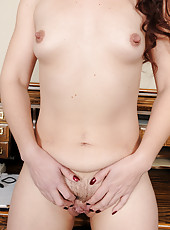 Redheaded secretary Sable yanks her panties asside to show pink