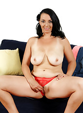 Busty 37 year old Leona Sweet lets loose her massive mams in here