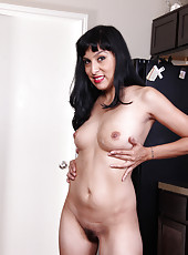 Petite 32 year old Betty Green from AllOver30 showing off hairy pussy