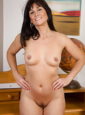 Beautiful brunette Lelani Tizzie from AllOver30 strips down after work