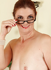 Cute 50 year old Linda L from AllOver30 wearing nothing but glasses