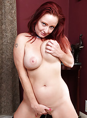 Busty redheaded Shelly Jones from AllOver30 playing maid and spreading