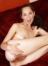 Cute and elegant brunette Fiona Filmore probing her mature pussy