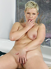 47 year old housewife Deide J creams her large boobs in the bathtub