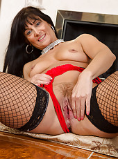 45 year old Lelani Tizzie opens her fishnet clad legs wide for you