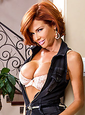 Veronica Avluv orders herself a gigolo. When Johnny shows up asking for directions she plays along, has him come inside, gives him a little wine and starts banging his brains out. After Johnny cums down her throat Veronica shows him out. That's when