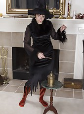 Harley stands as a sexy witch dressed in black and is sexy. She has very hairy legs that she shows us along with a very hairy pussy. She lifts her hairy pits to show us more and spreads her pink pussy too.