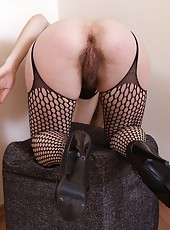 Gretta is a gorgeous babe who is wearing a sexy outfit with the crotch cut out, exposing her full bush that covers her entire pussy. This hairy pussy gets wet as she strips down.