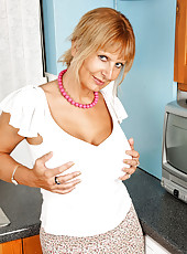 Blonde milf Alex pinches her boobs really hard and flaunting her tight ass