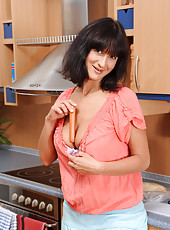 Housewife Chelsea seduces us as she plays with a hotdog in the kitchen