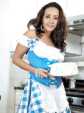 Hot Latin milf bakes a birthday cake in a naughty outfit