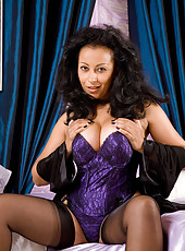Busty Anilos Donna shows off her sexy purple lingerie in her bedroom