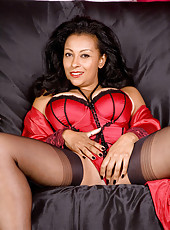 Glamorous Anilos milf Donna teases us with her sexy redhot lingerie on the couch