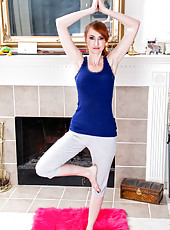 Sexy Anilos redhead Holly Jane shows off her flexibility during yoga